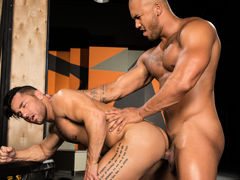 Tattooed Brazilian hunk Bruno Bernal caresses Jason Vario's massive, unchipped cock. Slick precum appears on the tip of Jason's cock, and Bruno smears it across Jason's sensitive head. Sinking to his knees, Bruno takes Jason's hard member in his gorge and mature gay fuck