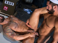 Bruno Bernal is going over some paperwork when Gabriel Taurus sneaks up from behind. Gabriel embarks on passionate kissing, their dark beards rubbing together. Opening his fly, Gabriel pulls out his thick, hefty cock, and Bruno eagerly strokes it. Falling mature gay fuck