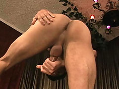 Sexy and horny tanned dude masturbating his cock in here