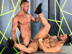 Tattooed Bruno Bernal lifts his chin to kiss towering Myles Landon. A light dusting of hair spreads across Bruno's bulging pecs, and his abs ripple as he kneels. Myles is a smooth, muscled bodybuilder; his nips are erect and his massive cock twitches wi mature gay fuck